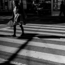 Woman Walking The Pedestrian Crossing