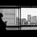 Buildings And Silhouette Of Man