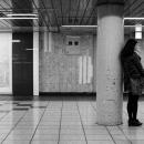 Young Woman Beside A Pillar