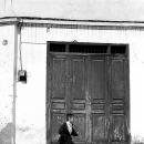 Boy Rushing Away In Front Of The Door