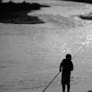 Silhouette Of A Fishing Boy