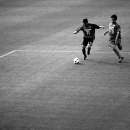 A Ball And Two Men On The Pitch
