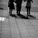 Parent And Children On The Sidewalk
