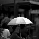 Older Woman With A White Umbrella