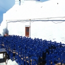 Blue Chairs Of A Church In Mykonos