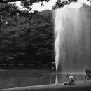 Woman Reading Books Near The Fountain @ Tokyo