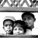 Three Children At The Other Side Of The Fence @ Sri Lanka