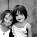 Two Girls Putting Their Arms Around Each Other's Shoulders @ Philippines