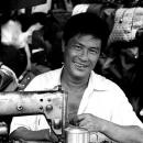 Foppish Man Beside A Sewing Machine @ Vietnam