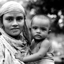 Mother Holding Her Anxious Baby @ Bangladesh