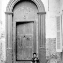 Boy In Front Of The Heavy Door