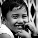 Boy Smiled While He Rested His Cheek On His Hands @ Myanmar