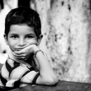 Boy Resting His Chin On His Hand @ India