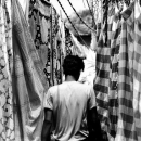 Man Walking Between Laundries @ India