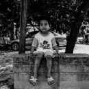 Boy Sitting On The Concrete Blocks