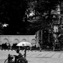 Trishaw With An Umbrella Stopped In The Square