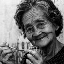 Older Woman Holding A Spoon