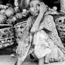 Shoeless Woman In The Market