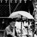 Man Waited For Customers Under The Umbrella
