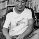 Man Binding A Book