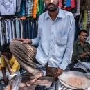 Bearded Man In A Clothing Stall