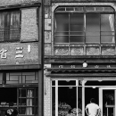 Two Men In Front Of Old Fashioned Shops