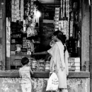 Mother Wearing Saree And Her Daughter At A Storefront