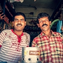 Two Men In A Small Shop