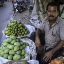 Man Selling Mango And Pomegranate