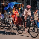Mother And Her Baby On The Cycle Rickshaw