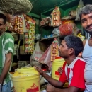Three Men Piddling Around In A Shop
