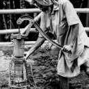 Man Getting Some Water From A Well