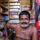 Tobacconist Was Stripped To His Waist