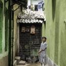 Boy With A Taqiyah In The Lane