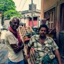 Two Rickshaw Wallahs Standing Talking