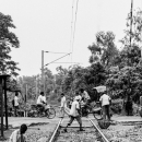 People On The Rail Crossing