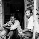 Men Relaxing In A Storefront