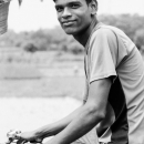 Smiling Young Man On The Bicycle