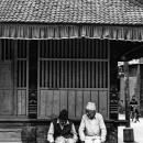 Two Sitting Men