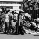 Uninterested Woman In The Street Market
