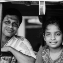 Father And Daughter On A Three-wheeler