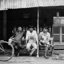 Three Men At A Small Tea Shop