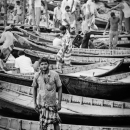 Man Wearing Lungi Stood On The Wooden Boat
