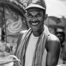 Smile Of A Rickshaw Wallah Wearing A Cap