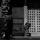 Slanting Boy In Front Of A Door
