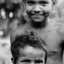 Smiling Little Boy And Girl With Pierced Ears