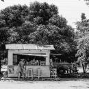 Man Standing At A Kiosk
