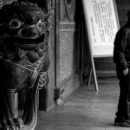 Guardian Dog And Man In Baoan Temple