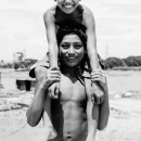 Smiling Boy Riding On The Shoulders