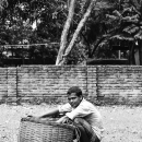 Man And Baskets In An Empty Lot